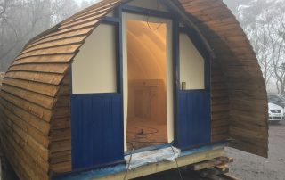 Closeup front of glamping cabin in workshop