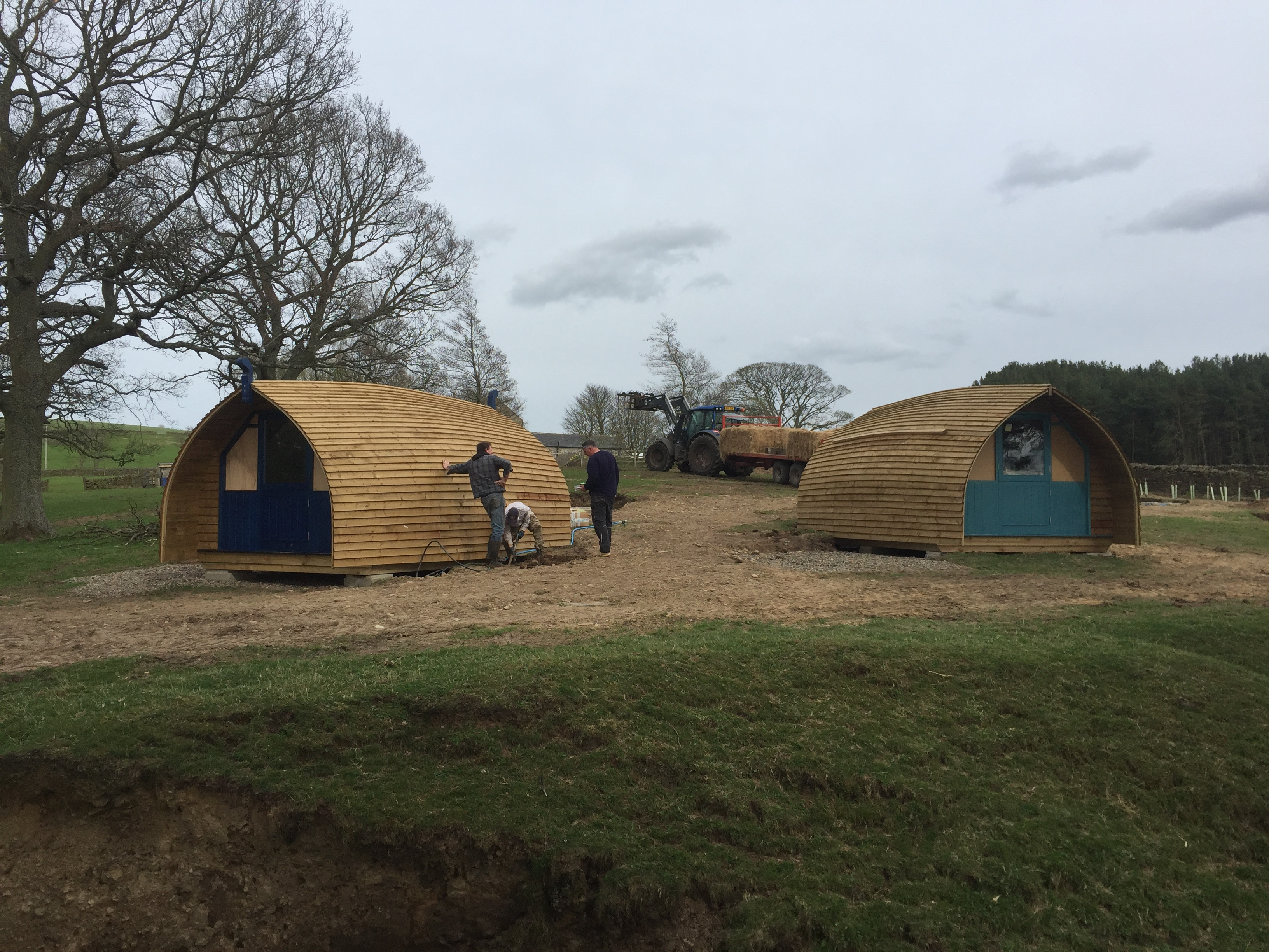 Two glamping cabins being moved into position