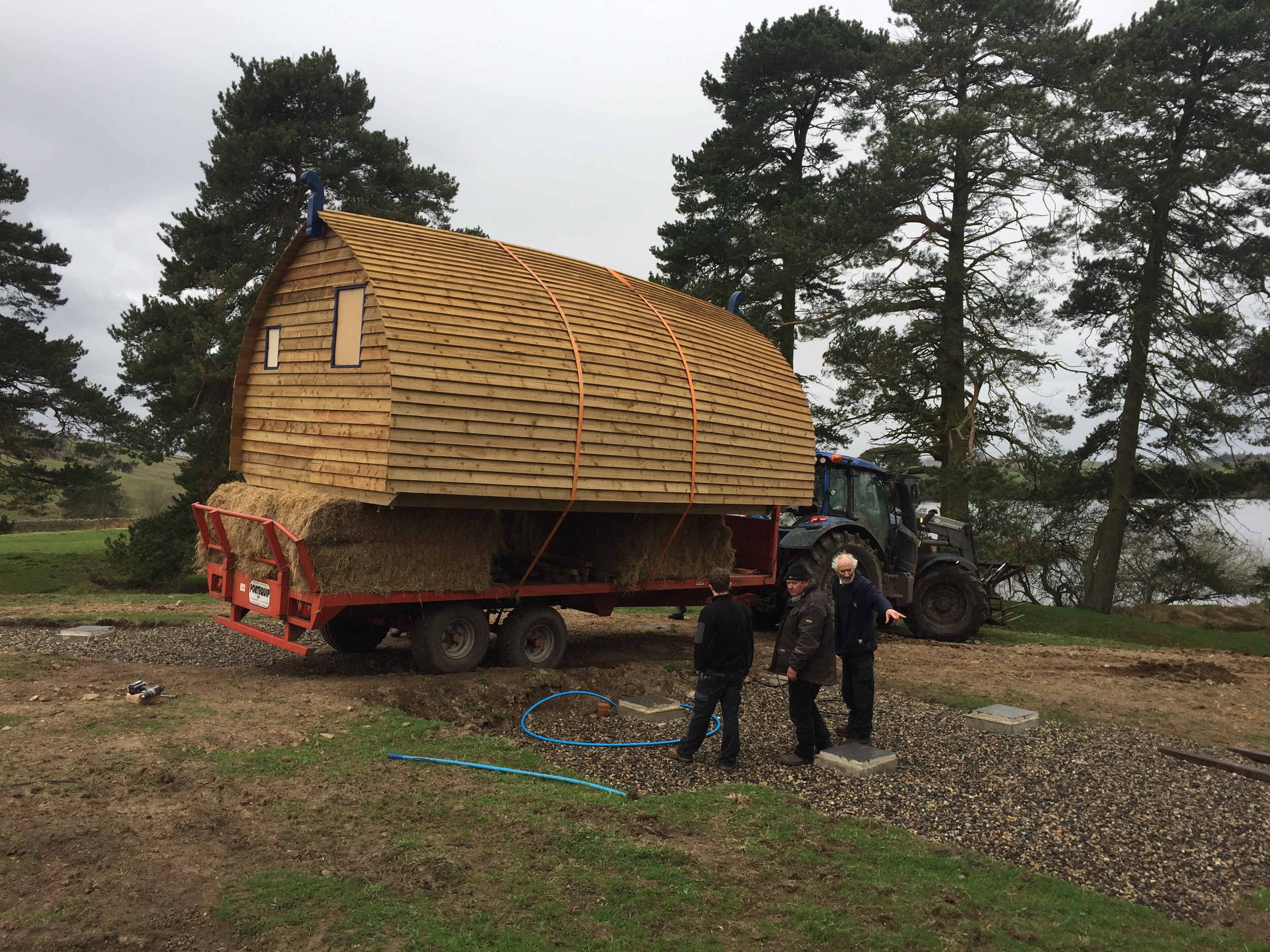Tractor carrying the first glamping cabin
