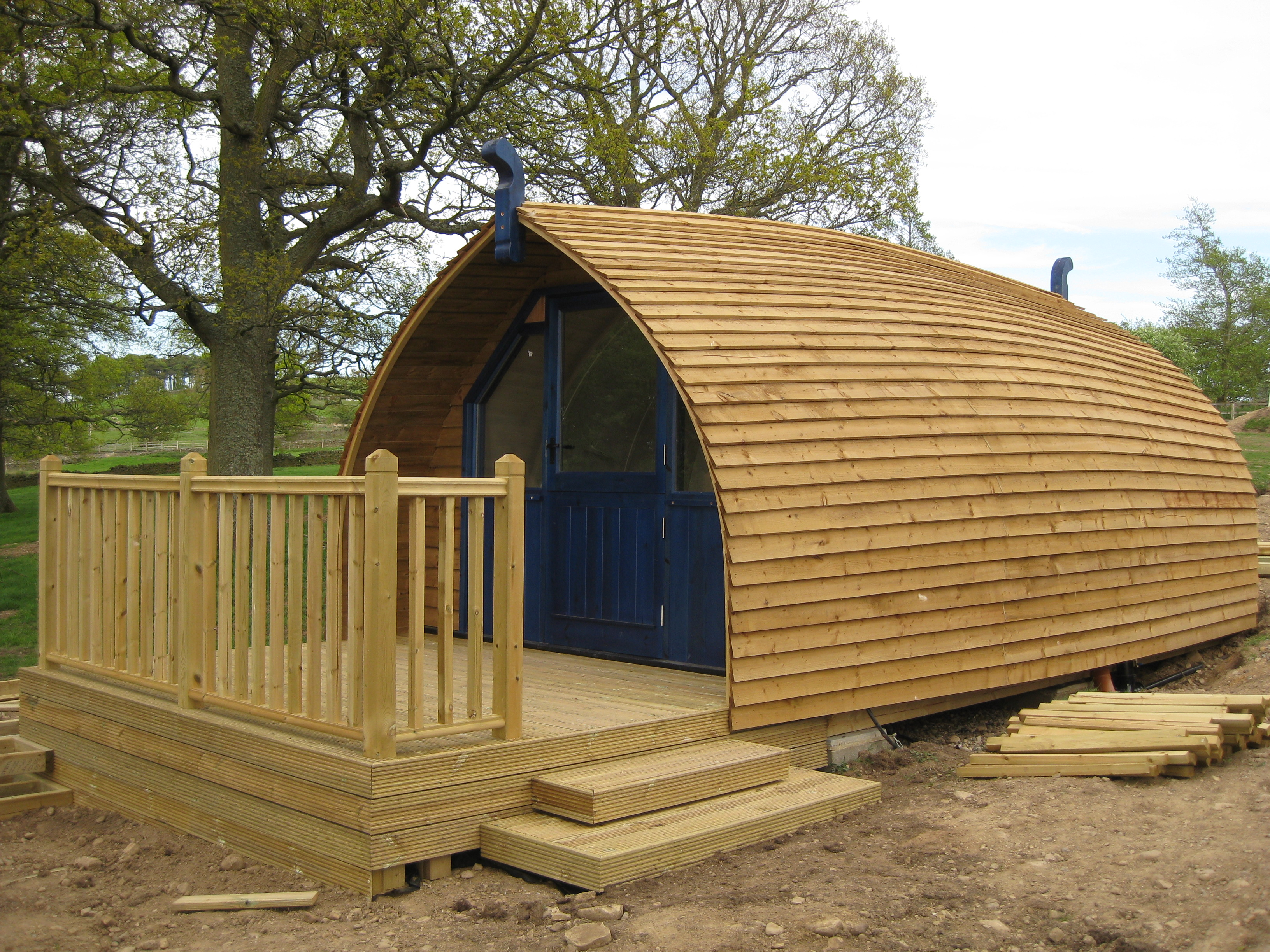 Side view of the glamping cabin being put in place