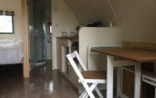 The seats, desk and kitchen